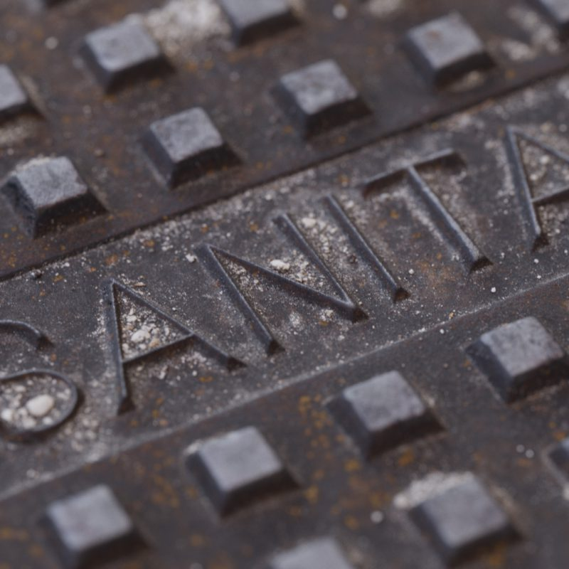 The image shows a render made using the manhole cover texture from Friendly Shade
