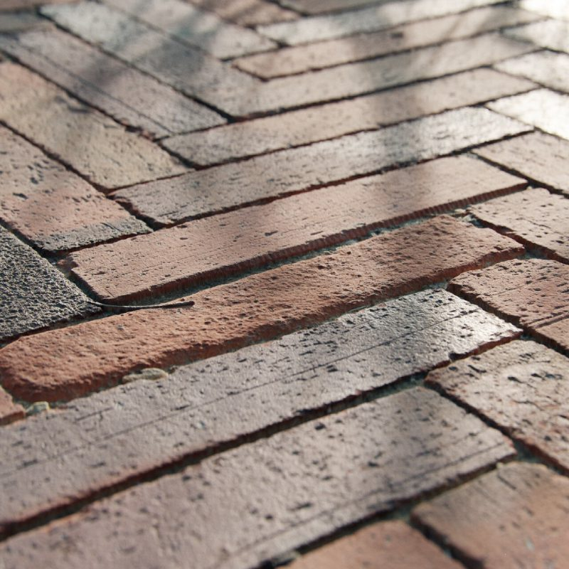 The image shows a herringbone pavement render made using Friendly Shade textures